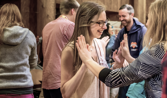 Impact Hub_Entrepreneurs at an event high-fiving each other